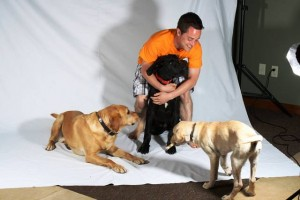 Syrus plays around with dogIDs team member Eric, River, and their buddy Aspen during a recent photo shoot.