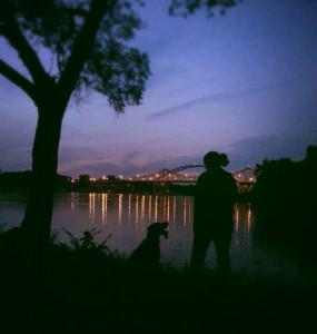 Dog and Owner standing outside at night
