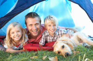 Family in a tent with dog