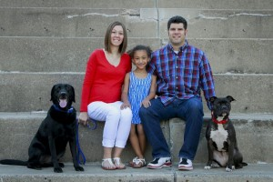 Ashley with her family and dogs, Jake and Maci.