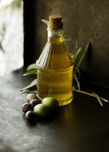 bottle of olive oil on a table